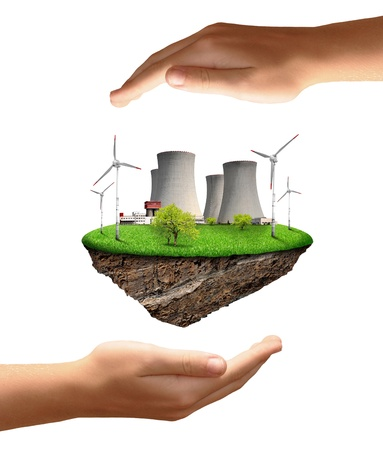 Little island with nuclear energy plant and wind turbines in hands Stock Photo - 15677809