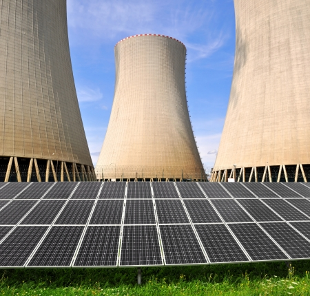 Solar energy panels before a nuclear energy plant  Stock Photo - 15677811