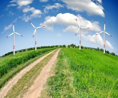 Field way with wind turbines - fisheye view photo