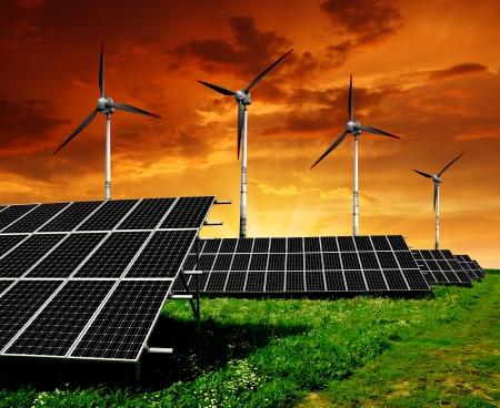 silicium: Solar panels and wind turbine in the setting sun  Stock Photo