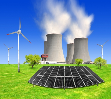 radiation pollution: spring landscape with nuclear power plant , solar panels and wind turbines  Stock Photo