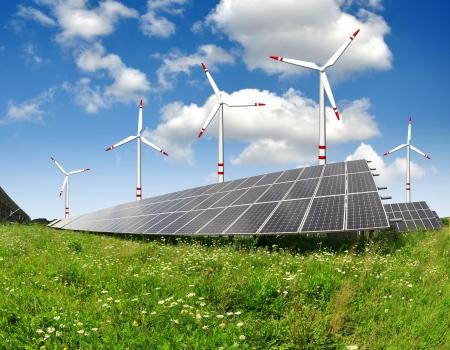 Alternativ: solar energy panels and wind turbine Stock Photo