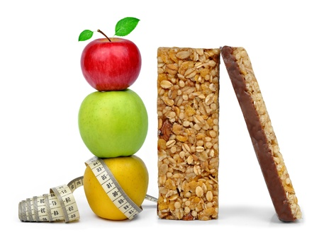 Chocolate Muesli Bars with apples isolated on white background  photo