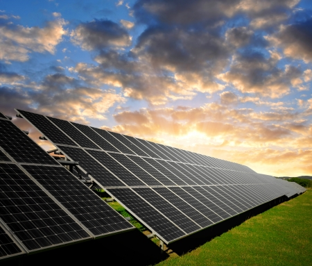 energy costs: Solar energy panels in the setting sun