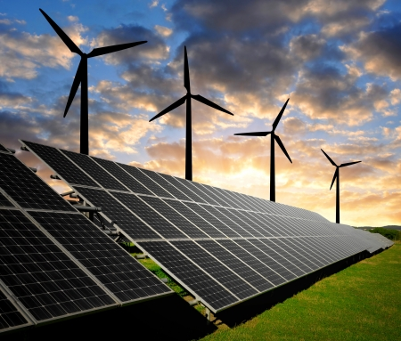 wind power plant: Solar panels and wind turbine in the setting sun  Stock Photo