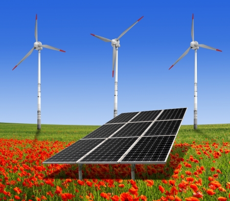 solar energy panels and wind turbine on the poppy field  photo