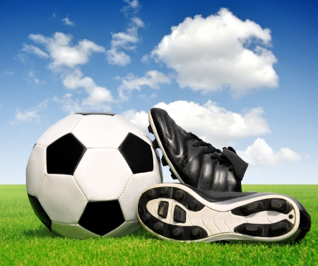 football shoes: soccer ball and shoes in grass  Stock Photo