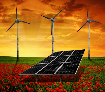 Solar energy panels with wind turbines in the sunset  photo
