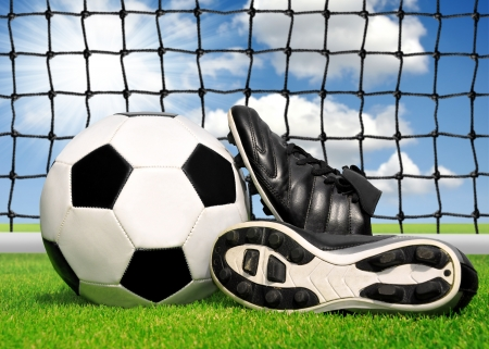 soccer cleats: soccer ball and shoes in grass  Stock Photo