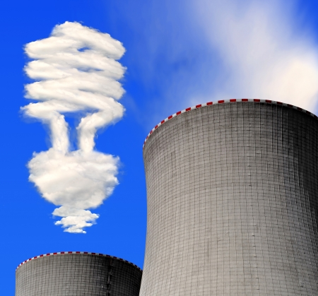 nuclear plant: Nuclear power plant with bulb from clouds Stock Photo