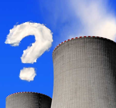 Nuclear power plant with question mark from clouds photo