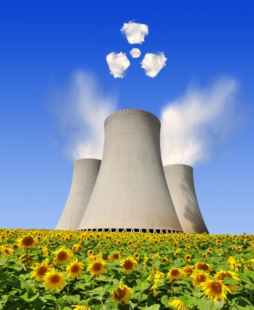 Nuclear power plant with radiation symbol from clouds  photo