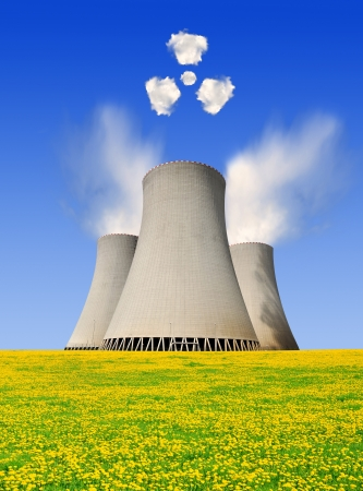 Nuclear power plant with symbols radiations from clouds  photo