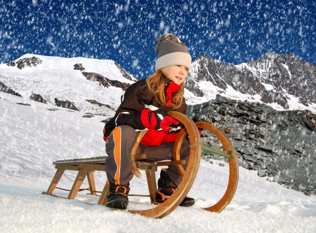 girl on a sleigh  Stock Photo - 17079311