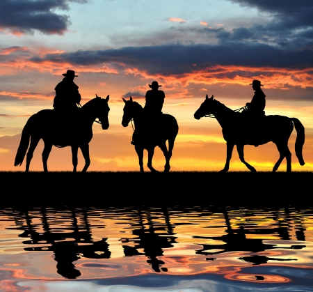 cowboy on horse: Silhouette cowboys with horses in the sunset