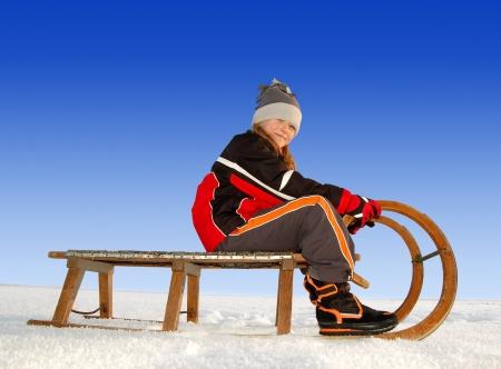 girl on a sleigh Stock Photo - 17076131