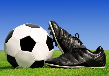 soccer shoes: soccer ball and shoes in grass  Stock Photo