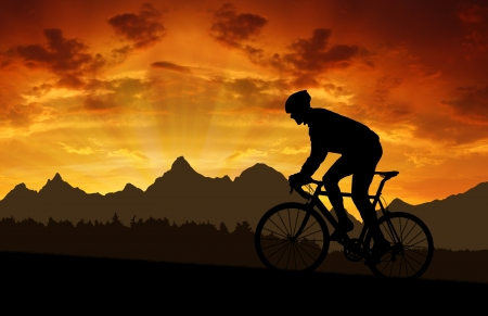 road bike: silhouette of the cyclist riding a road bike at sunset