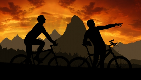 mtb: mountain bikers silhouette in sunset