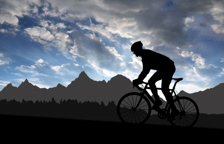rapidity: silhouette of the cyclist riding a road bike at sunset