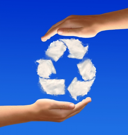 greenhouse gas: Recycling symbol from clouds in the hands