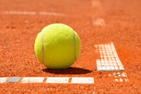 tennis clay: Tennis ball on a tennis clay court  Stock Photo