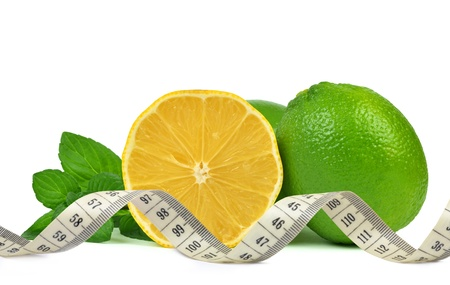 Lemons and Limes with mint leaves photo