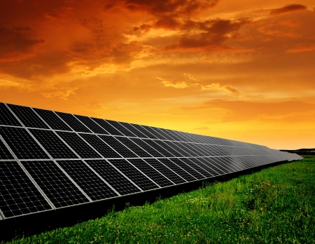 environmental: Solar energy panels in the setting sun  Stock Photo