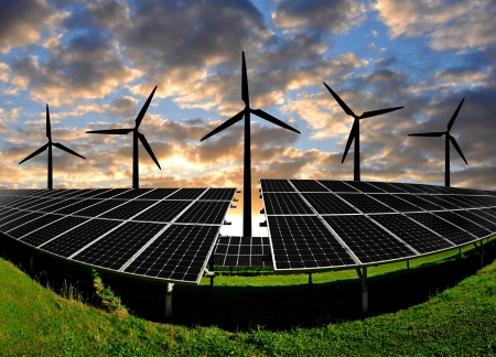 energy costs: Solar energy panels with wind turbines in the sunset