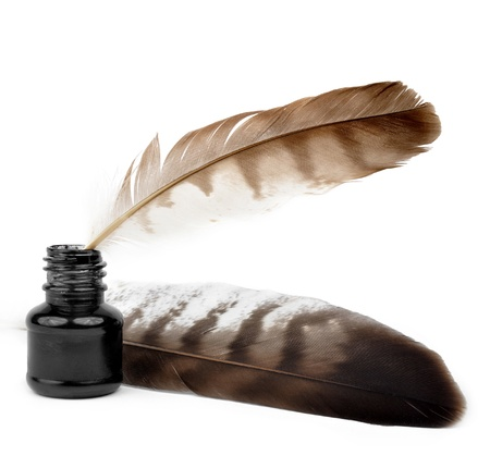 literary: Feathers and ink bottle  Stock Photo