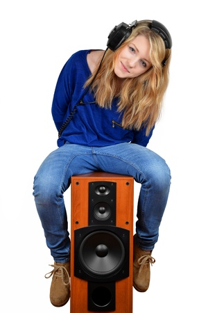 amps: the girl sitting on the speaker isolated on white  Stock Photo
