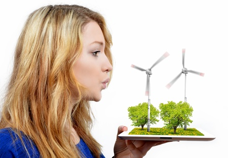 girl blowing on the wind turbines  photo