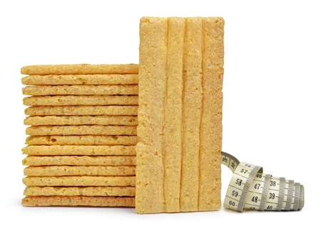 wheat slices with measuring tape isolated on white  photo