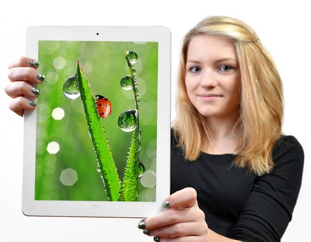 girls holding a tablet computer - isolated over a white background  photo