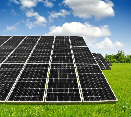 Solar energy panels against blue sky with clouds Stock Photo