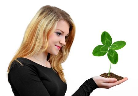quarterfoil: Girl holding in hand clover quarterfoil