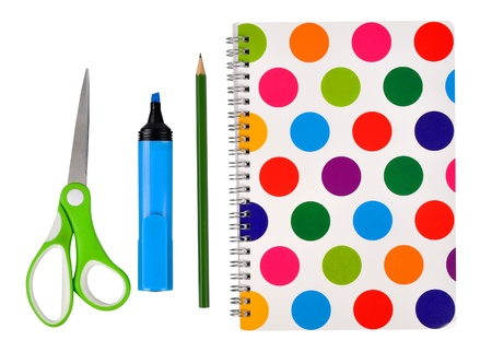 workbook with felt-tip, pencil and scissors photo