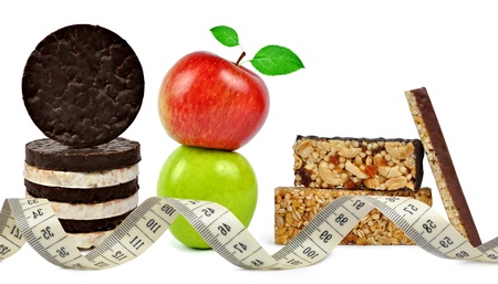 Chocolate Muesli Bars with apple and measuring tape isolated on white background  photo