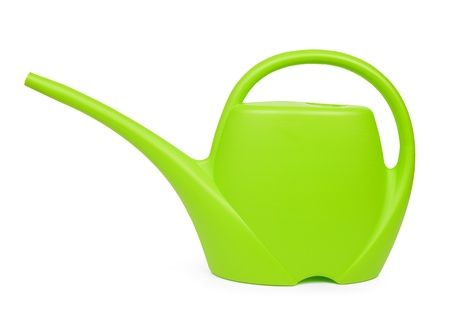 green watering can isolated on white background  photo