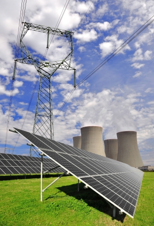 Alternativ: Solar energy panels and nuclear power plant  Stock Photo