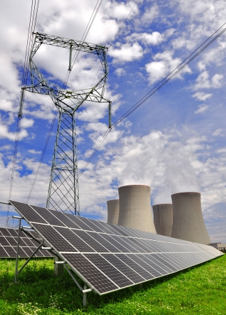nuclear power plant: Solar energy panels and nuclear power plant  Stock Photo