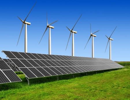 energy costs: solar energy panels and wind turbines  Stock Photo