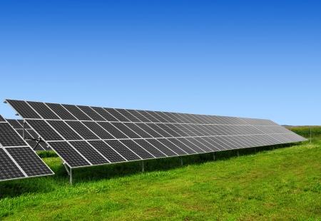 Solar energy panels against blue sky  photo