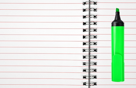 workbook: workbook with green felt-tip Stock Photo