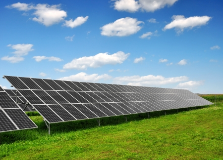 Solar energy panels against blue sky with clouds  photo