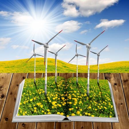 educacion ambiental: Abra el libro ecológico con turbinas de viento en tablones de madera
