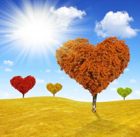 Autumn landscape with tree in the shape of heart Reklamní fotografie
