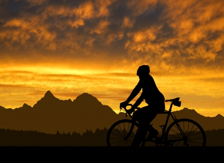 rapidity: silhouette of the cyclist on road bike at sunset