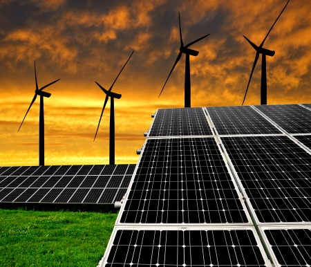 silicium: Solar energy panels with wind turbines in the setting sun  Stock Photo