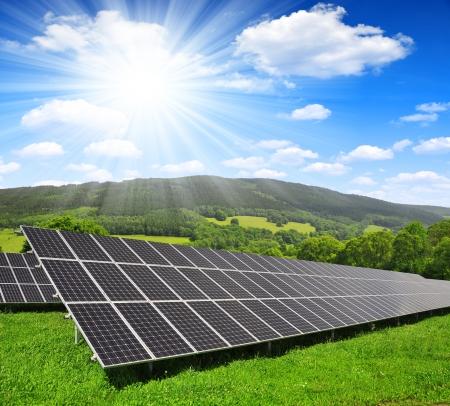 Solar energy panels in spring landscape photo